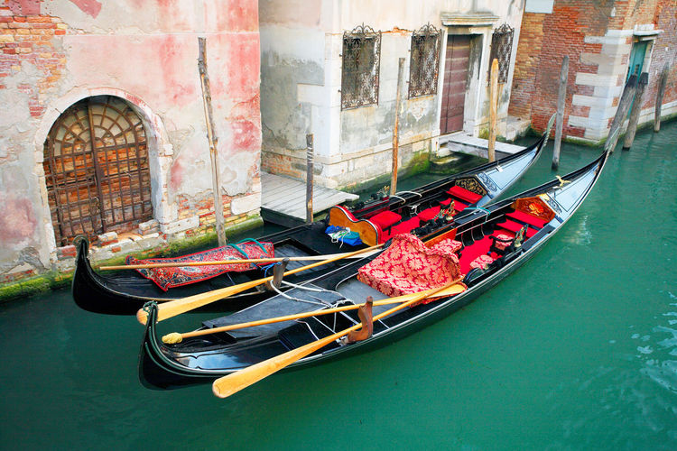 High angle view of gondolas moored on grand canal by houses