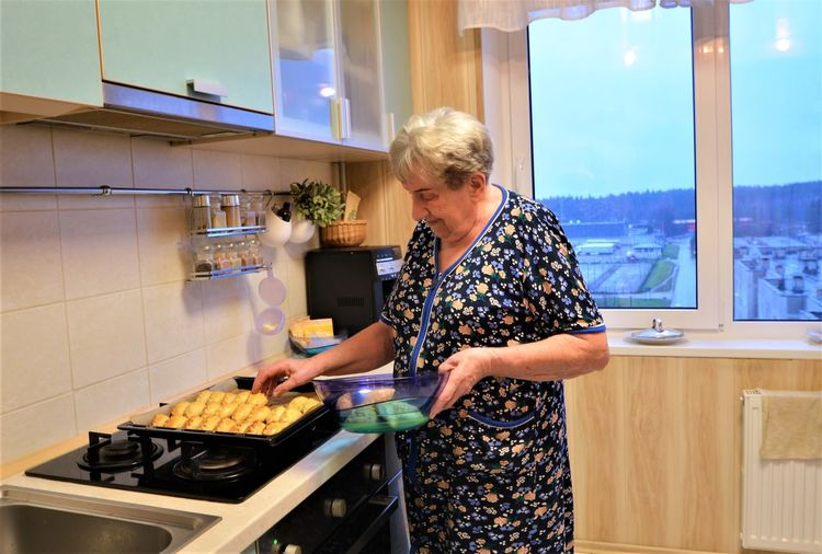 Full length of woman having food at home