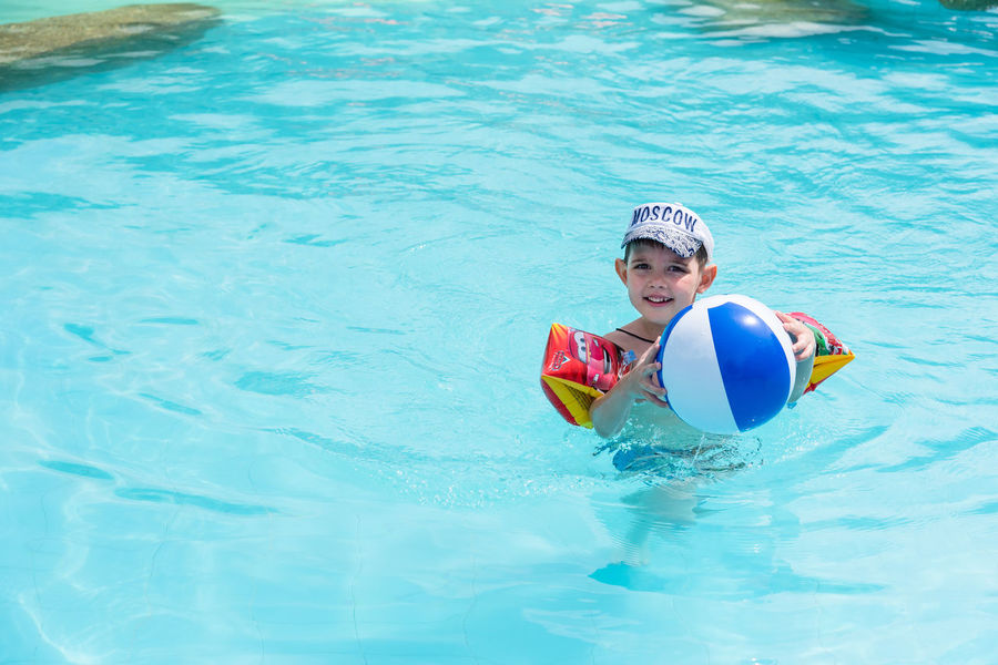 Trat, Thailand - May, 21, 2017 : Unidentified name Boys swimsuit floating and playing with ball in the swimming pool at Klong Prao Resort in Prao Beach Koh Chang island Trat, Thailand. Blue Childhood Day Editorial  Floating On Water Happiness Illustrative Illustrative Editorial Inflatable  Inflatable Ring Leisure Activity Looking At Camera Nature One Person Outdoors People Pool Raft Portrait Real People Smiling Swimming Swimming Pool Thailand Water