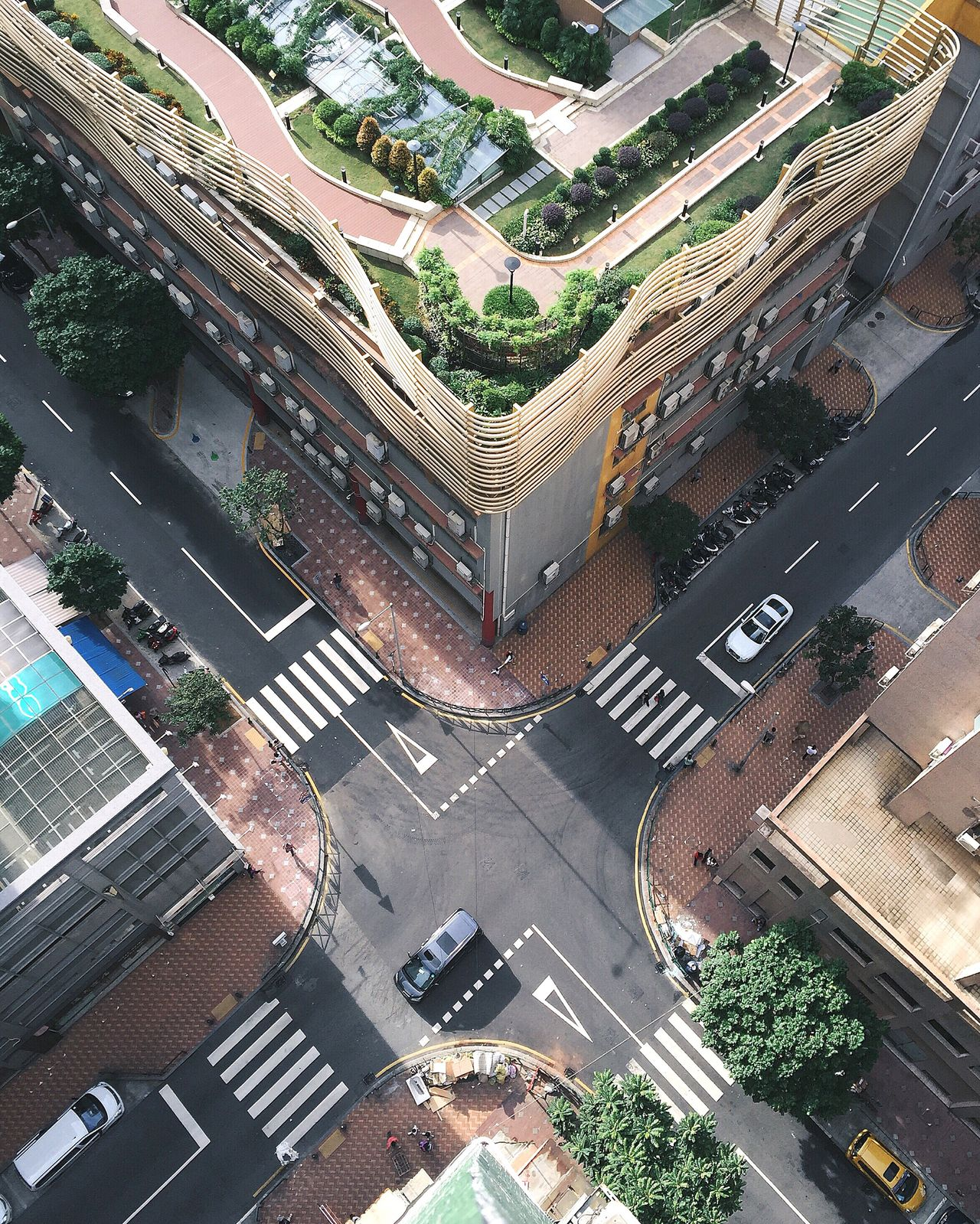 High angle view of cars on city street amidst buildings