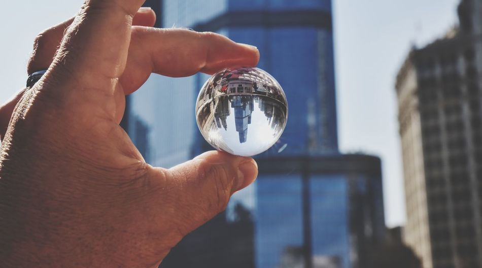 EyeEm Selects city skyscraper seen in a round clear globe Sphere Crystal Ball Human Hand Human Body Part Fortune Telling Holding Reflection Close-up Ball Crystal City Orb Connection Prism Globe Bradleywarren Photography Bradley Olson Copy Space Skyscraper Urban Urban Skyline Urban Landscape Urban Geometry Photography Props