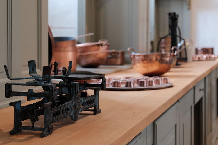 Old kitchen Indoors  Food And Drink Establishment Day Kitchen Domestic Room No People Bookshelf Objects Edwardian Victorian Decay Abandoned Old Pots Pot Close Up Close-up Kitchen Art Kitchen Utensils Technology Store Antique Indoors  Copper  LIBRA