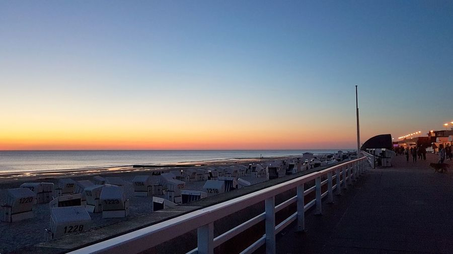 Promenade Sylt Strand Architecture Beach Beauty In Nature Built Structure Clear Sky Dusk Horizon Horizon Over Water Incidental People Land Nature Nordsee Outdoors Railing Scenics - Nature Sea Sky Sunset Sylt Sylt_collection Tranquility Water Westerland