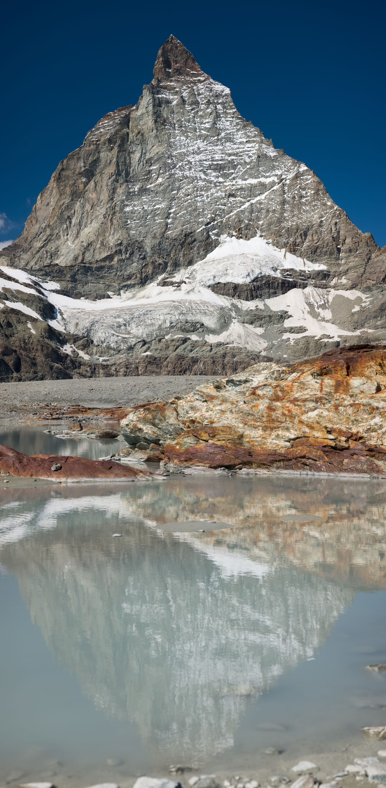 mountain, water, cold temperature, snow, scenics - nature, environment, beauty in nature, winter, landscape, nature, sky, ice, reflection, mountain range, no people, glacier, travel destinations, lake, frozen, tranquility, tranquil scene, blue, land, travel, snowcapped mountain, day, outdoors, clear sky, non-urban scene, rock, lagoon, tourism, mountain peak