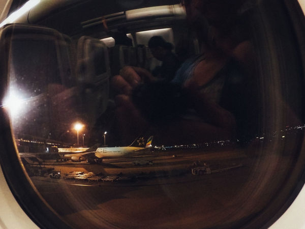 Airplane Airport Boarding Enjoy Finding New Frontiers Flight Glitch Indoors  Night People Pivotal Ideas Reflection Shadows & Lights Silhouettes Start A Trip Transportation Traveling Home For The Holidays Vacations Vehicle Interior Window Break The Mold