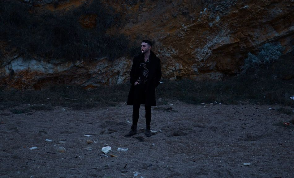 3/006 Pollution Rubbish Menstyle Menswear Black Hair Sand Floral Sandy Beach Fashion Photography All Saints  Coat Beach Fashion Beard Full Length One Person Standing Real People Lifestyles Leisure Activity Front View Contemplation Night Land Nature Clothing Outdoors