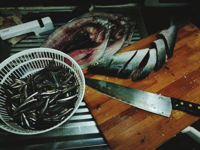 Cleaning the fish Fish Fish Cutting Cooking Food Preparation Cleaning Fish High Angle View Table Close-up
