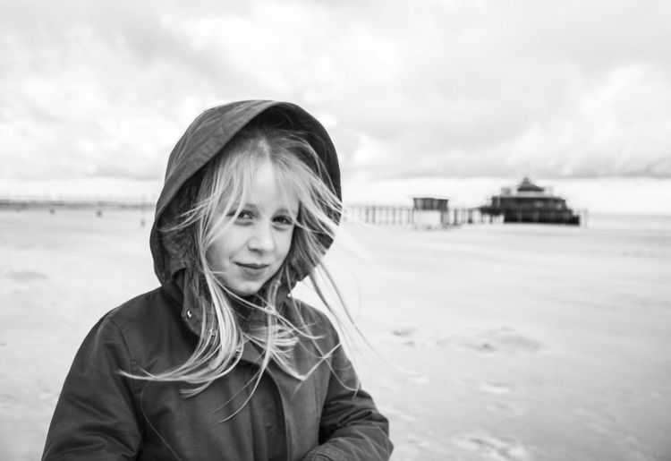 windy, cloudy Beach Casual Clothing Cloud - Sky Focus On Foreground Front View Girl Headshot Leisure Activity Lifestyles Looking At Camera Person Pier Portrait Sea Sky Smiling Standing Waist Up Water