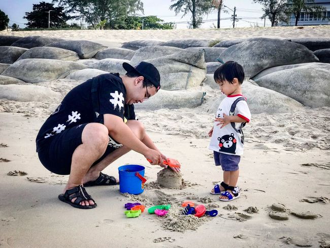 Father and kid playing with sand on tropical beach Sea Nature People Travel Love Life Is A Beach Family Son Fun Toy Building Childhood Child Real People Full Length Males  Men Boys Leisure Activity Land Togetherness Lifestyles Family Two People Sand People Day Beach Nature Positive Emotion