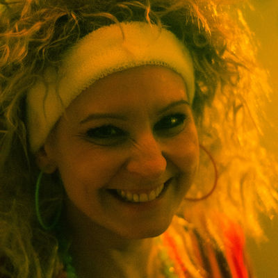 In the middle of an 80s theme party. 80s Party Caucasian Cheeky Close-up Drunk Frizzy Hair Girl Grin Hallucinate Indoors  Jane Fonda Lifestyles LSD Mood One Person Party People Real People Singing Stage Light Woman Yellow Light The Portraitist - 2017 EyeEm Awards