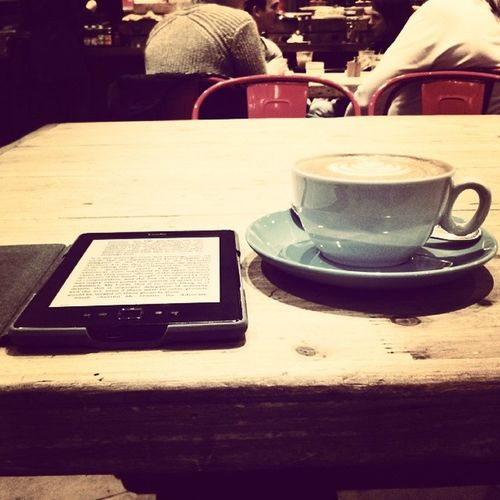 Coffee and kindle. Can't get a much better way to kill a solitary afternoon Flatwhite Asuitableboy Vikramseth Kindle grind