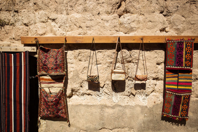 Bags drying on clothesline on wall