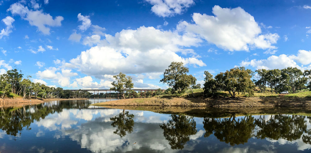 View of Melton Reservoir Mirror Reflection Beauty In Nature Blue Bridge - Man Made Structure Cloud - Sky Day Lake Melton Nature No People Outdoors Rail Railroad Railroad Bridge Reflection Reservoir Scenics Sky Tranquil Scene Tranquility Tree Water EyeEmNewHere