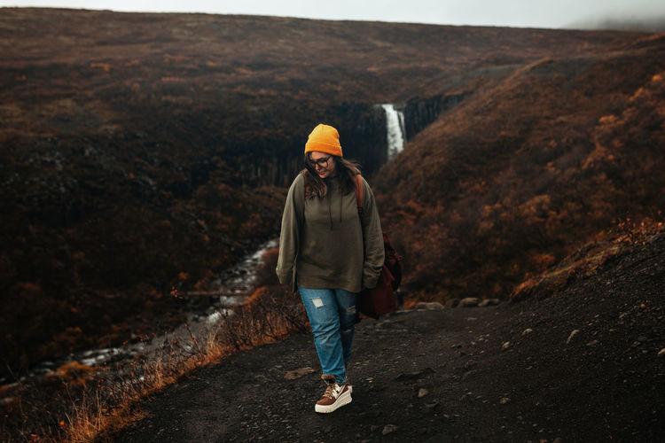 Full length of man walking on rock