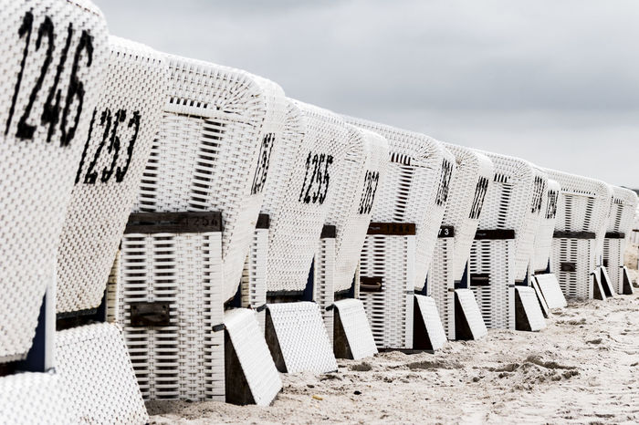 white beach chairs Architecture Beach Building Exterior Built Structure Close-up Day Island Nature No People North Germany Northsea Outdoors Sand Schleswig-Holstein Sky Sylt, Germany White Beach Chairs