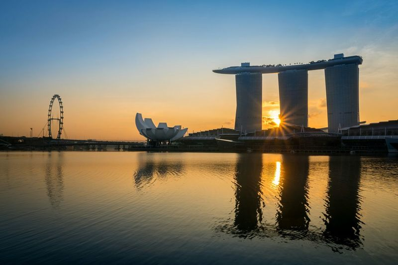 Singapore sunrise Singapore Sunrise Goodmorning Traveling Marina Bay Sands Hotel Marina Bay Being A Tourist Amazing Architecture Golden Hour Cityscapes Seeing The Sights Landscapes With WhiteWall light and reflection Neighborhood Map