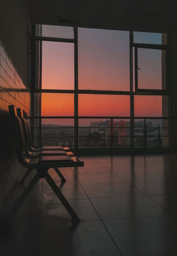 Scenic view of orange sky seen through glass window