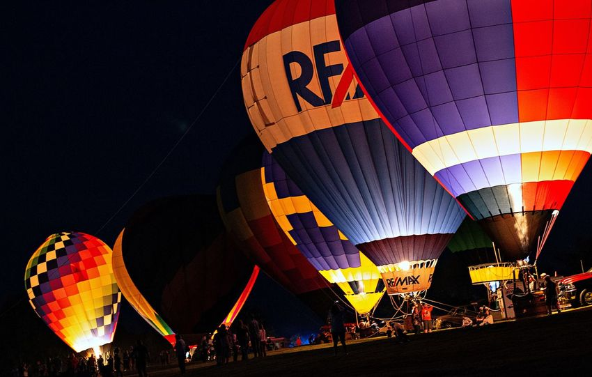 Adventure Air Vehicle Balloon Ballooning Festival Celebration Festival Group Of People Hot Air Balloon Illuminated Incidental People Leisure Activity Mode Of Transportation Multi Colored Nature Night Outdoors Real People Traditional Festival Transportation Travel