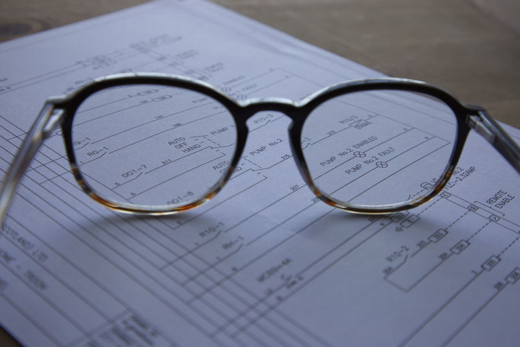 Close-up of eyeglasses on paper