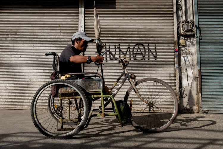Man with bicycle on street