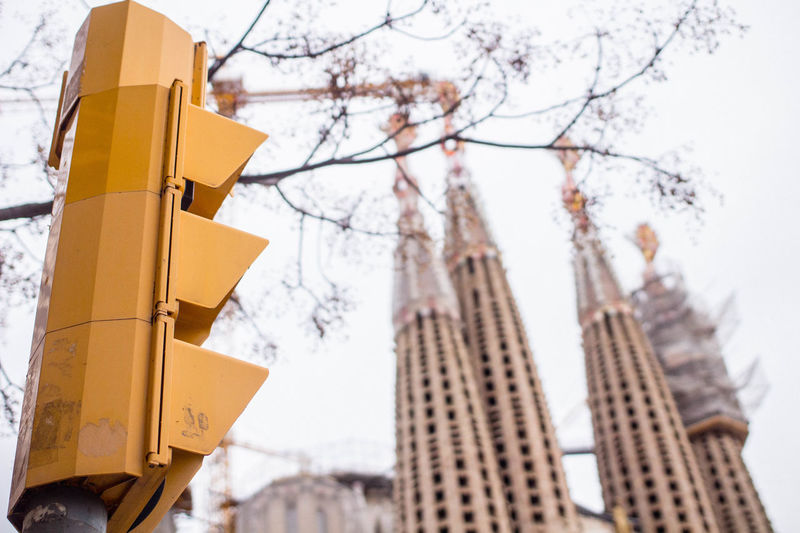 Barcelona Catalonia Catalunya Sagrada Família Basilica Traffic Winter Architecture Barcelona Winter Bare Tree Branch No People Outdoors Religion Sagrada Familia Sagradafamilia Sagradafamiliabarcelona Sagradafamiliachurch Sky Traffic Light  Traffic Lights Tree