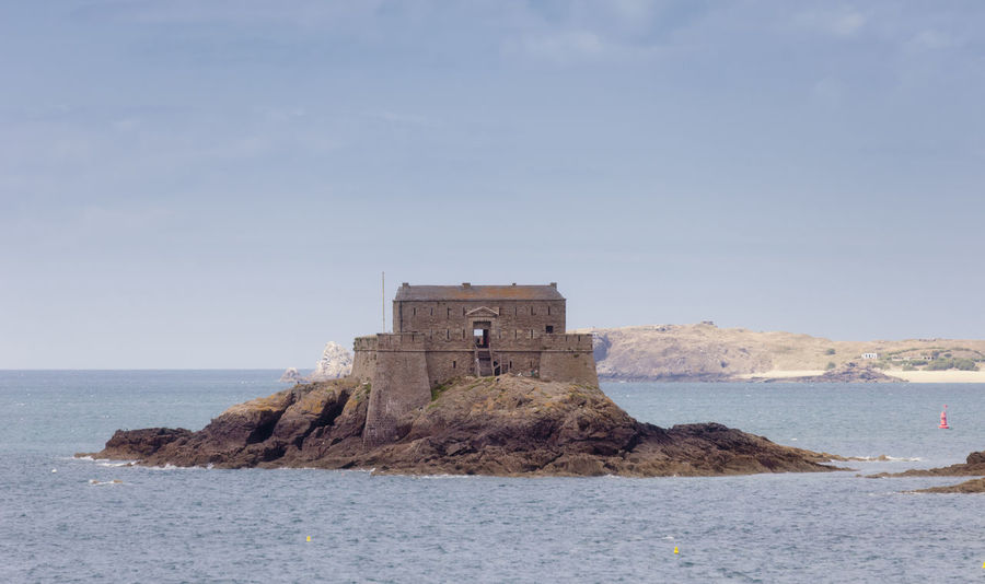 Fort on tidal island Petit Be in Saint-Malo - Saint-Malo, Brittany, France - The fort was built in the 17th century. It was part of the defense belt designed by Vauban to protect the city of Saint-Malo from British and Dutch fleets. Ancient Architecture Atlantic Ocean Bretagne Brick Building Brittany Building Exterior Fort Fortress France Medieval Military No People Old Old Ruin Petit Bè Protection Saint-Malo Scenics Sea Seascape Tidal Island Travel Destinations Vauban Water