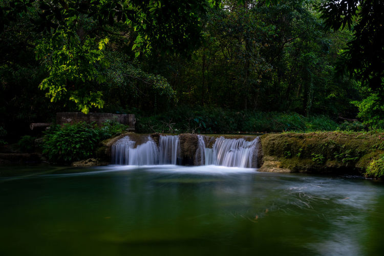 Beautiful waterfall in Thailand, Namtok Chet Sao Noi Park, Saraburi, featuring lush green tropical vegetation, long exposure Thailand Namtok Chet Sao Noi National Park Provence Water Forest Long Exposure Waterfall Scenics - Nature Motion Beauty In Nature No People Blurred Motion Rainforest Non-urban Scene Land Waterfront Green Color Nature Flowing Power In Nature Falling Water Outdoors