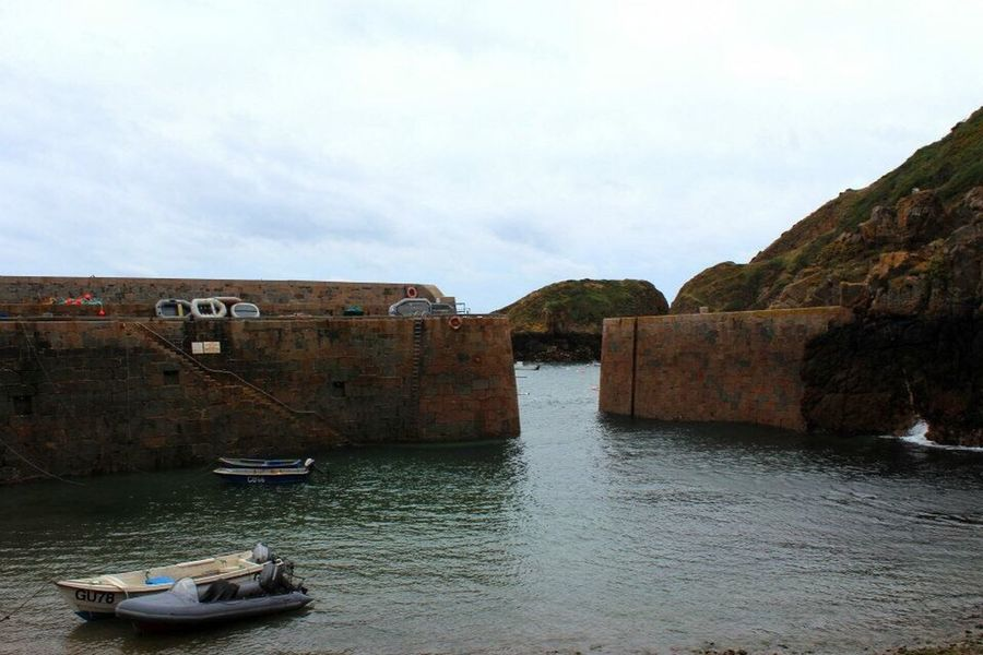 Sark breakwater Sark Channel Islands Water Boat Mode Of Transport Sky Tourism Dusk Sunset Outdoors Rocks Cloud Idyllic