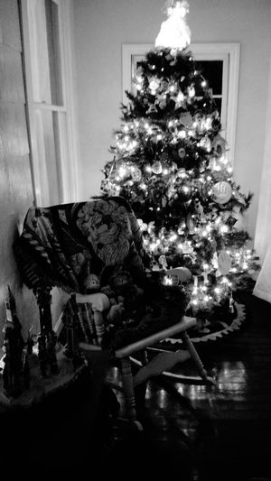 Christmas tree pine lights holidays green red santa rocking chair black and white celebrate