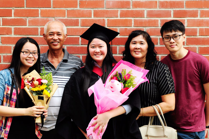 Achievement Campus Celebration Ceremony Degree Education Family Gown Graduation Happy Joy Malaysian Mortar University Asian  Outdoor Female Women Sister Sibling Males  Group Success