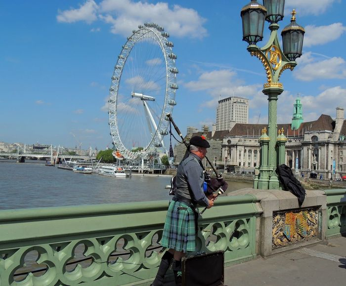 EyeEm LOST IN London London Eye Architecture Bridge - Man Made Structure Building Exterior City Cityscape Cloud - Sky Day Ferris Wheel Leisure Activity Lifestyles Men One Person Outdoors Railing Rear View Sky Standing Travel Destinations Water Women