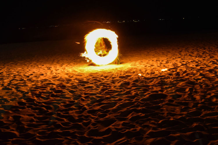 Fire dance Beach Burning Fire Dancer Flame Heat - Temperature Illuminated Long Exposure Motion Night Outdoors Wire Wool