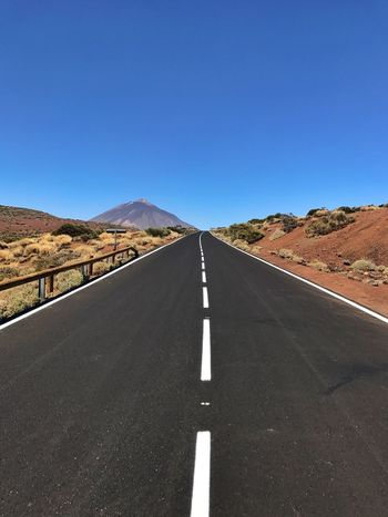 Road Clear Sky Road Marking Transportation Copy Space The Way Forward Landscape White Line Day Mountain Blue Asphalt Tranquil Scene Empty Nature Outdoors Tranquility Dividing Line No People Scenics