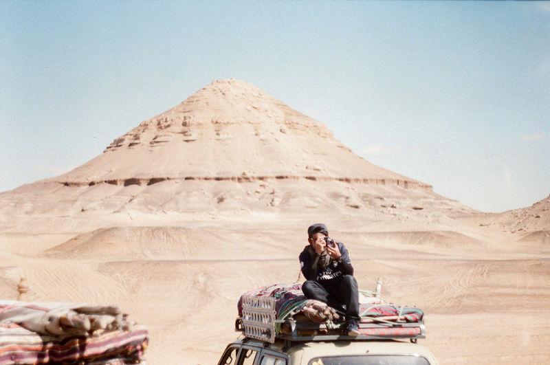 Woman sitting on a desert