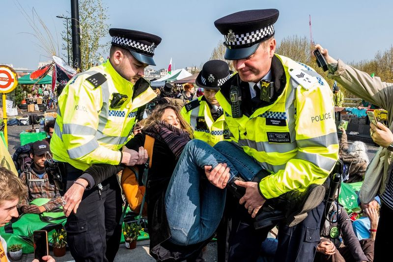Extinction Rebellion protester arrested on Waterloo Bridge Extinction Rebellion Group Of People Real People Day People Men Nature Lifestyles British Culture My Best Photo The Photojournalist - 2019 EyeEm Awards