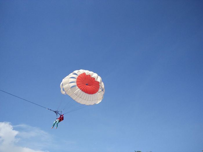 Adventure Blue Day Fun Low Angle View Mid-air Multi Colored No People Outdoors Red Sky Parasailing Watersports Nusadua Tanjungbenoa Bali, Indonesia Shore