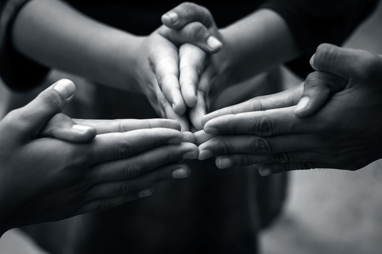 Close-Up Of Children's Hands Playing