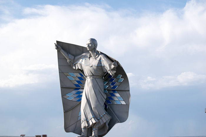 Dignity Native American Indian South Dakota Statue Art And Craft Chamberlain Cloud - Sky Craft Creativity Day Environment Female Likeness Human Representation Low Angle View Male Likeness Metal Native American Nature No People Outdoors Protection Representation Sculpture Security Silver Colored Sky Statue