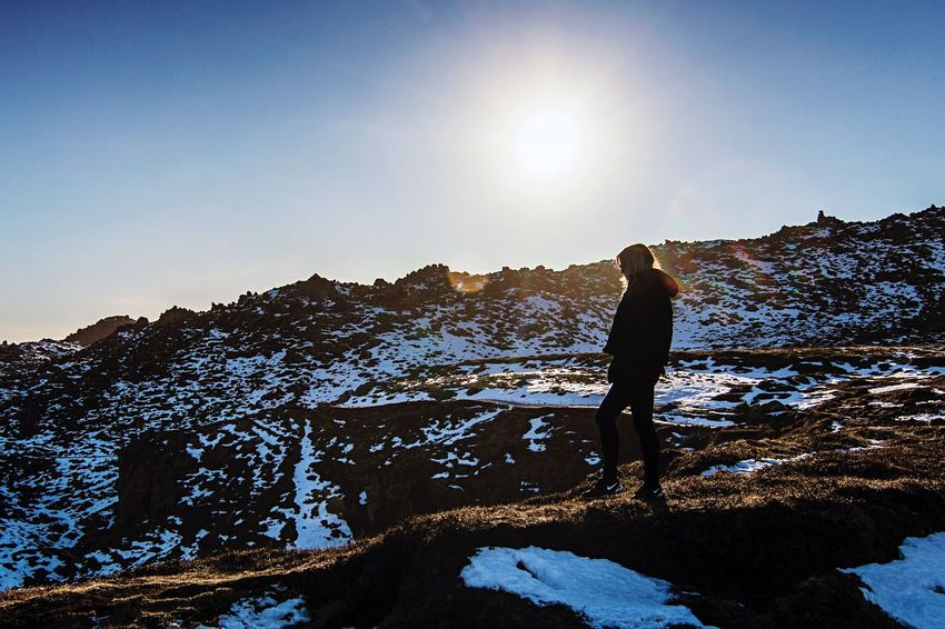 Iceland Arnarstapi Snaefellsnes Peninsula Snow Winter Cold Temperature Mountain Scenics One Person Mountain Range Beauty In Nature Sunlight Nature Hiking Real People Leisure Activity Non-urban Scene Landscape Lifestyles Outdoors Adventure Clear Sky Tranquility