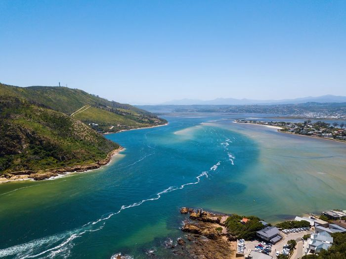 Beautiful city and lagoon of Knysna along Garden route in South Africa Knysna Lagoon Knysna South Africa Knysna Water Sea Scenics - Nature Beauty In Nature Sky Land Nature Beach Blue Tranquil Scene Tranquility Coastline High Angle View Bay