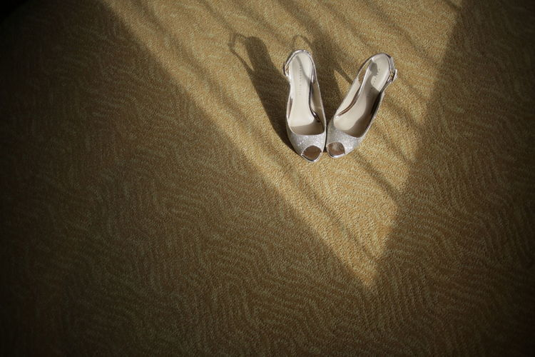 High angle view of sandals on carpet