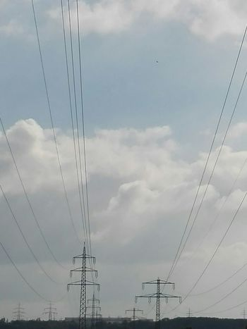 Strom Kabel Power Supply Electricity  Connection Electricity Pylon Power Line  Fuel And Power Generation Technology Cable Low Angle View Sky Cloud Day Cloud - Sky Electricity Tower Outdoors Blue Complexity No People Pylon