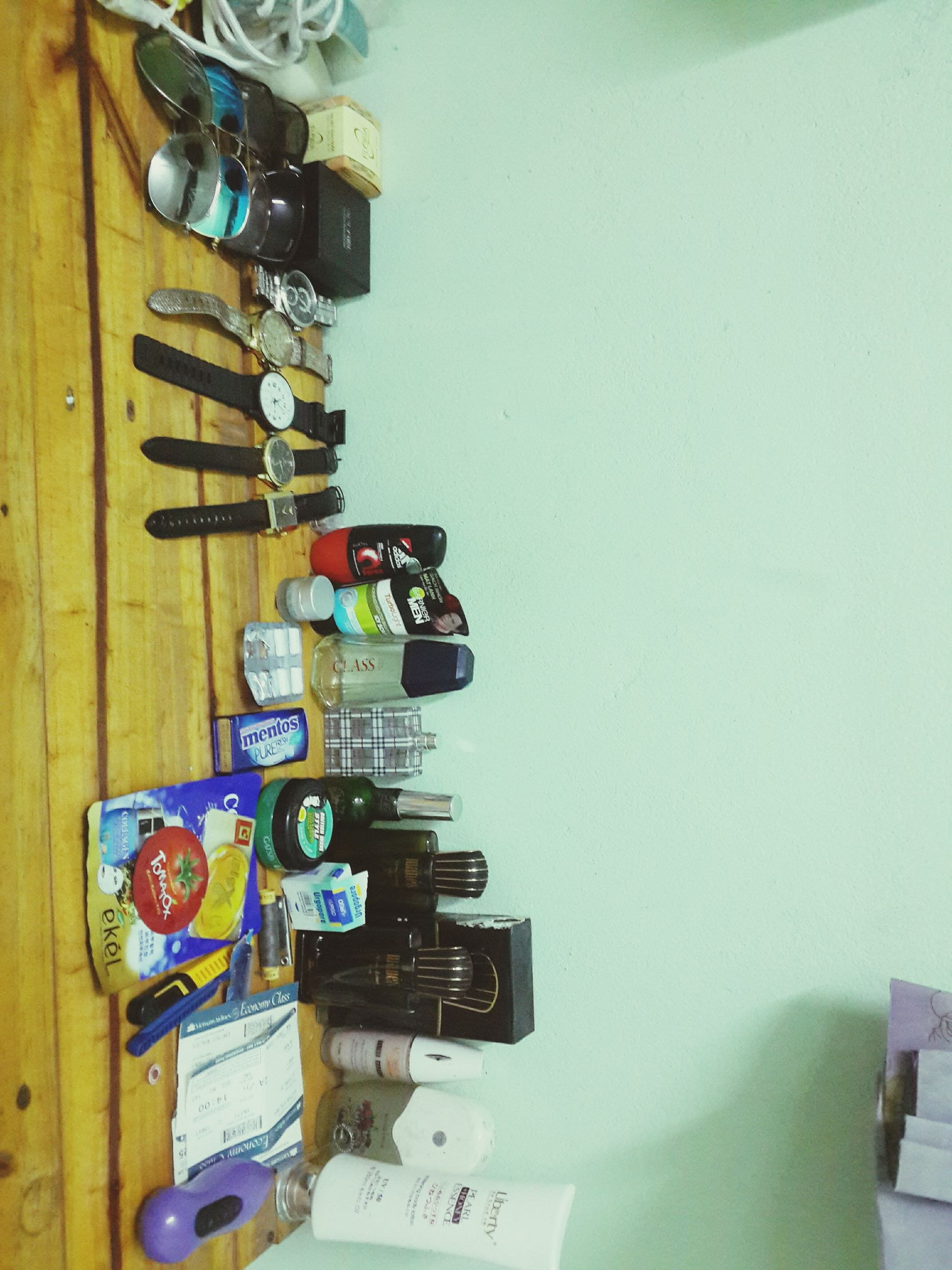 indoors, communication, text, variation, technology, large group of objects, western script, still life, choice, no people, hanging, wall - building feature, equipment, number, control, close-up, wood - material, in a row, blue, non-western script