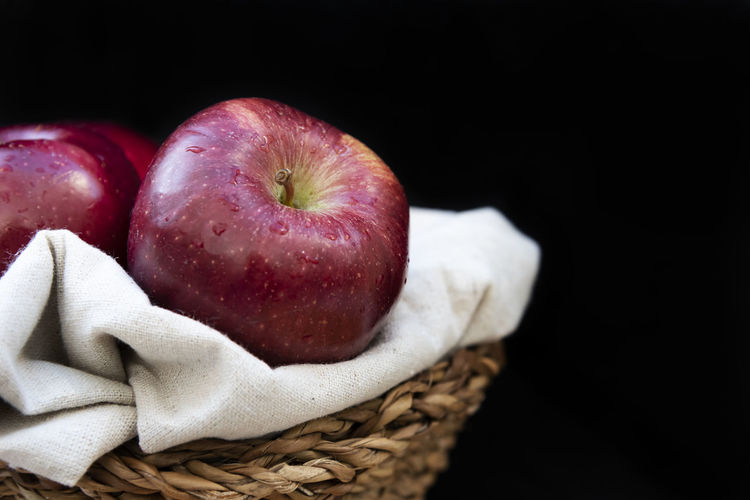 Healthy and organic red apples in a wicker basket on black background with copy space Fruit Food Freshness Indoors  Red No People Close-up Apple Red Organic Healthy Wicker Backet Background Wallpaper Copy Space Summer Delicious Tasty Diet Agriculture Vegetarian Food Drops Water Blackandwhite