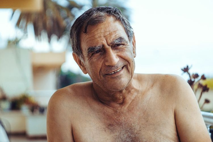 Portrait of shirtless mature man