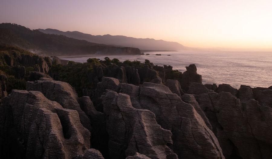 Unusual rock formations,oceans coast during sunset.punakaiki pancake rocks, west coast, new zealand