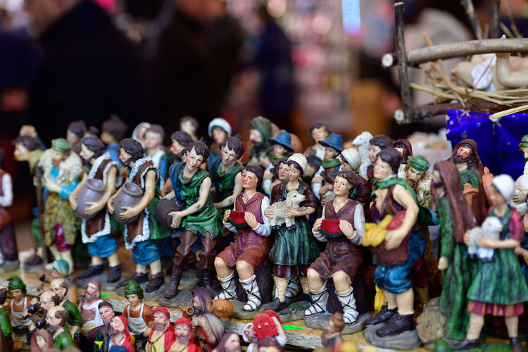 Close-up of figurines for sale in market