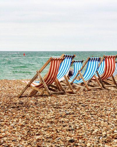 Beach Sea Horizon Over Water Outdoors Beach Chairs Colour Clear Sky Pebbles