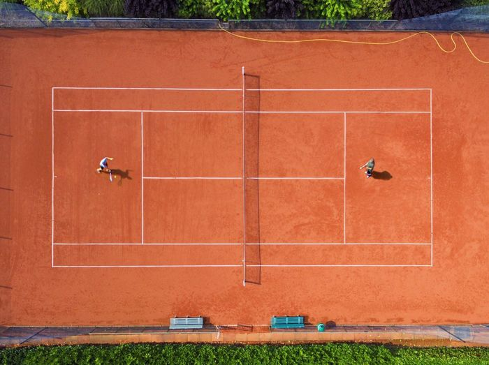 Directly Above Shot Of Athletes Playing Tennis At Court