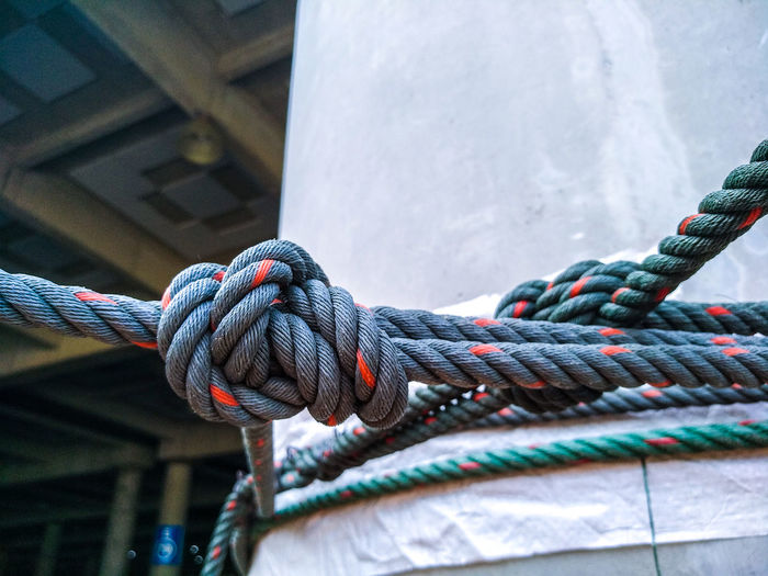 Close-up of ropes tied on rope